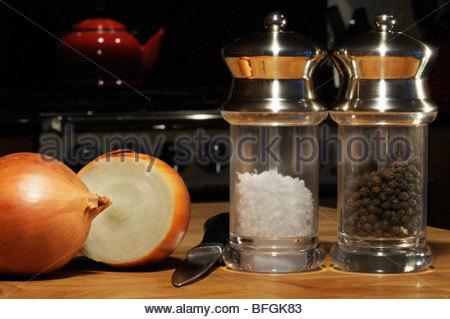 Onion on chopping board - Stock Photo