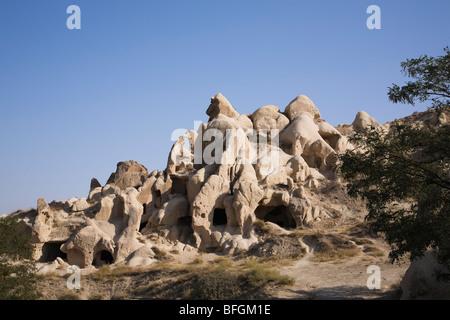 Rock-cut cave dwellings in the Goreme valley, Cappadocia region, Turkey - Stock Photo