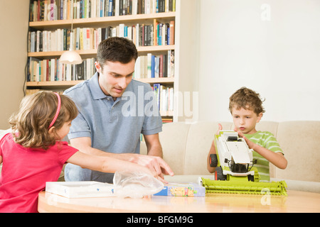 father playing with kids - Stock Photo