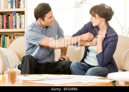 couple arguing about money - Stock Photo
