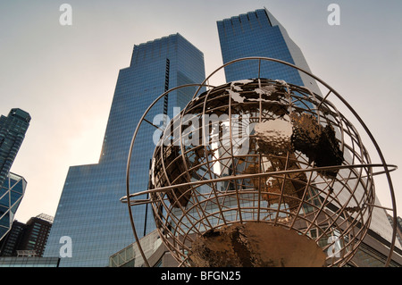 Globe outside Trump International Towers with highrises in background, Columbus Circle, New York City, New York - Stock Photo