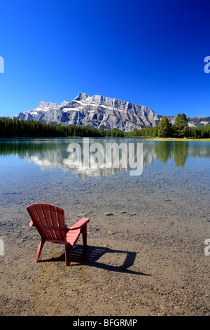 Deck chair at Two Jack Lake, Banff National Park, Alberta, Canada. - Stock Photo