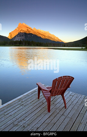 Chair on jetty at Vermillion Lake with Mount Rundle in background. Banff National Park, Alberta, Canada. - Stock Photo