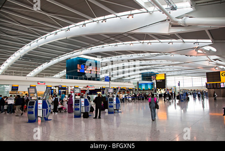 Departures concourse terminal 5 Heathrow international airport London England UK - Stock Photo
