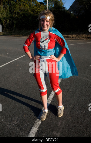 Teenage girl in super hero costume - Stock Photo