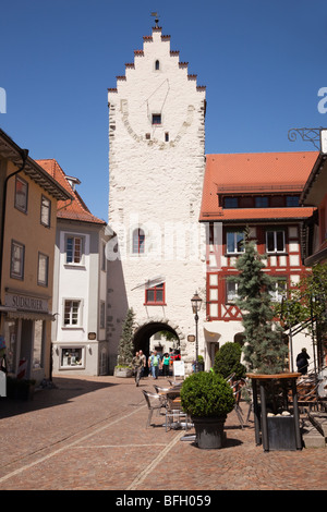 Marktstrasse, Markdorf, Baden-Wurttemberg, Germany. Old gateway and large sundial on cobbled street within Altstadt - Stock Photo