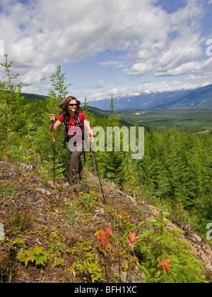 A woman enjoys the tremendous scenery on a beautful day near Valemount, Thompson Okanagan region, British Columbia, - Stock Photo