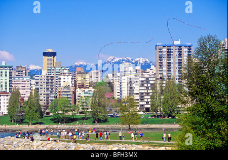 Flying kites along the waterfront in Vanier Park,  Vancouver, British Columbia, Canada - Stock Photo