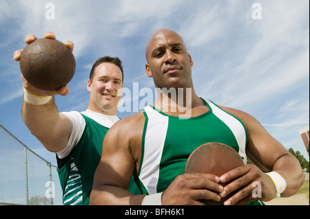 how to hold a shot put ball