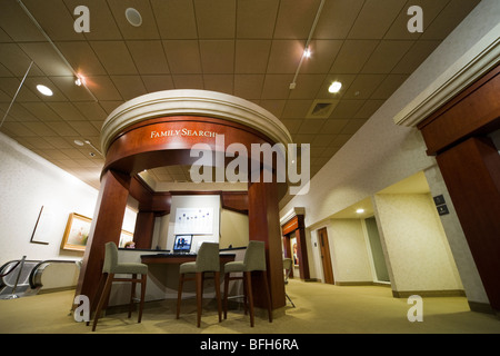 Salt Lake City South Visitor Center on Temple Square. Visitors doing genealogical research on FamilySearch terminals. - Stock Photo