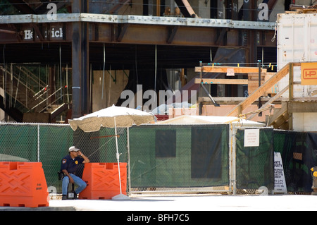 Security guard at a construction site - Stock Photo