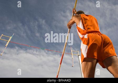 Pole-vaulter preparing for jump - Stock Photo