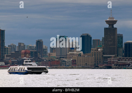 A Seabus crosses the Vancouver harbour towards downtown Vancouver. - Stock Photo