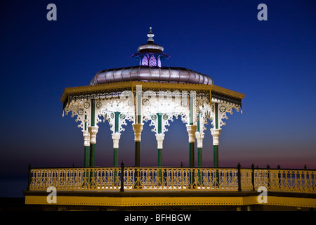 The Grade 2 listed Victorian bandstand on Brighton and Hove seafront just after sunset - Stock Photo