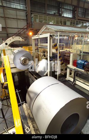 Rolls of sheet steel in a car body factory - Stock Photo