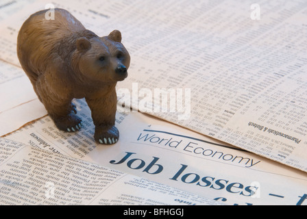 A Bear over the World Economy reports of Job Losses representing the Finance Markets - Stock Photo