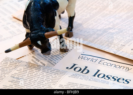 A Bull over the World Economy reports of Job Losses representing the Finance Markets - Stock Photo