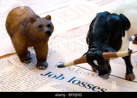 A Bull and Bear over the World Economy reports of Job Losses representing the Finance Markets - Stock Photo