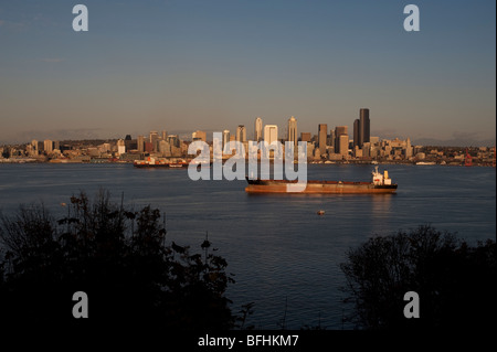 Seattle skyline from West Seattle with tankers in Elliott Bay at sunset Washington State USA - Stock Photo
