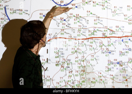 Doctor Eric Rasmussen points at a weather forcast map in Wichita, Kansas, USA, June 9, 2009 - Stock Photo