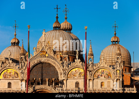 Warm glow of sunset on the detailed architecture of the Basilica San Marco in Venice, Veneto Italy - Stock Photo