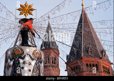 Ongoing preparations for a christmas market illumination in front of a 1000 year old cathedral in a city in Germany - Stock Photo
