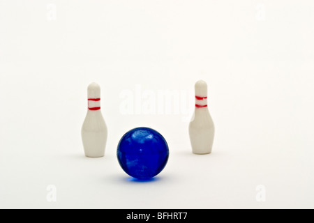 Small toy bowling ball heading for a seven ten split - Stock Photo