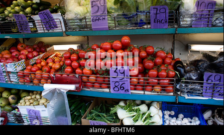 Vegetables for sale on stall in Green Lanes North London UK - Stock Photo