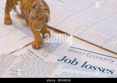 A tiger over the World Economy reports of Job Losses representing the Asia Markets - Stock Photo