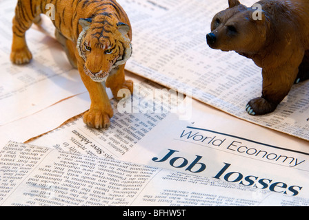 A tiger and Bear over the World Economy reports of Job Losses representing the Asia Markets - Stock Photo