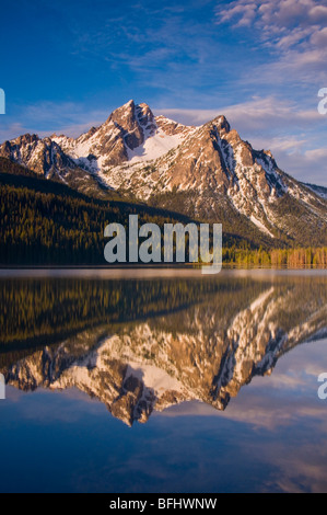 USA, IDAHO, Sawtooth National Recreation Area, Sawtooth Mountains, Snow covered McGowen Peak reflecting in scenic - Stock Photo