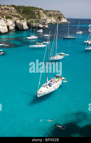 Yachts anchored in Cala Macarella, Menorca, Spain - Stock Photo