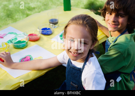 Kids Painting Outside - Stock Photo