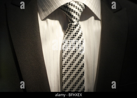 Close up Midsection View Of A Mens Suit, Shirt and Tie - Stock Photo