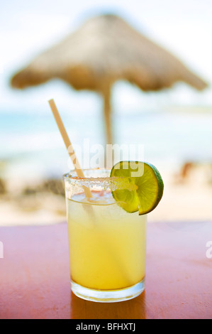 Close-up of cocktail on a table in a bar on the beach, Mexico - Stock Photo