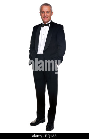 A mature male wearing a black tuxedo and bow tie, isolated on a white background. - Stock Photo