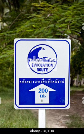 Tsunami evacuation route sign. Ko Hua Khwan (Chicken Island). Krabi Province. Thailand - Stock Photo