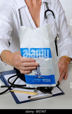 NHS prescription paper bag containing prescribed drugs - Stock Photo