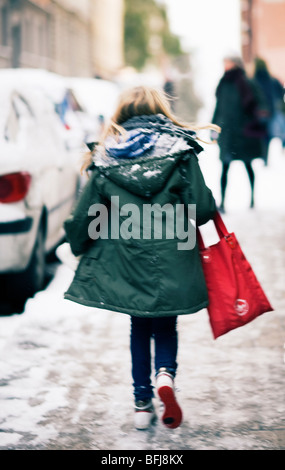 A girl walking on a street, Stockholm, Sweden. - Stock Photo