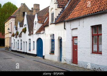 St Jan In De Meers, a quiet cobbled street in Bruges, Belgium. - Stock Photo