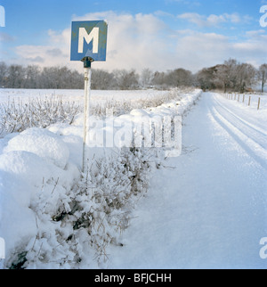 A meeting sign on a winter road, Sweden. - Stock Photo