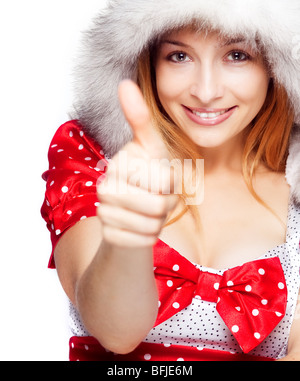 Winter portrait of happy woman showing ok sign - Stock Photo