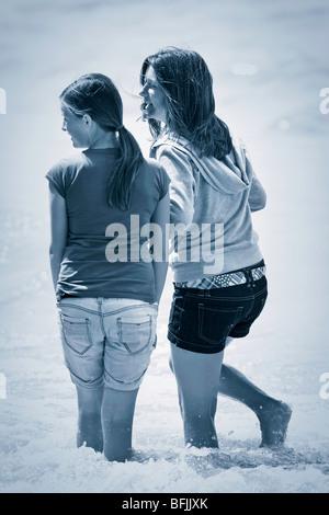 Two teenage girls, Lake Winnipeg, Hecla Island Provincial Park, Manitoba, Canada. - Stock Photo