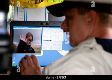 A weather channel production assistant assists reporter Katy Tur with a live streaming broadcast from western Kansas, - Stock Photo