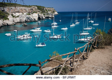 Yachts anchored in Cala Macarella, Menorca, Spain - Stock Photo