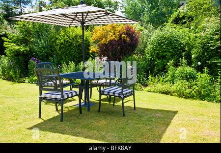 cottage garden patio with metal table furniture and