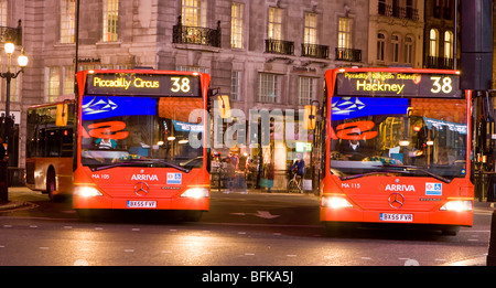 London Buses in Piccadilly Circus at Night - Stock Photo