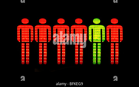 Yellow and Red men of German Pedestrian-Traffic-Light Walking Men, Germany. - Stock Photo