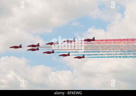The Red Arrows aerobatic display team in formation during a level flypast. - Stock Photo