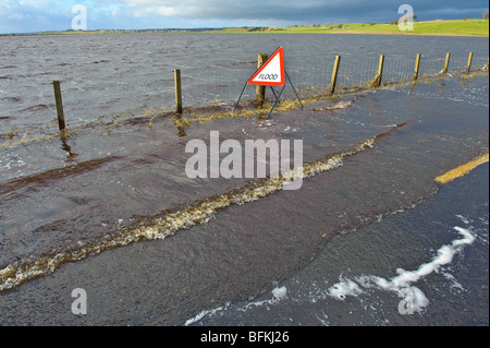 Flood warning sign on flooded road in South Lanarkshire Scotland - Stock Photo
